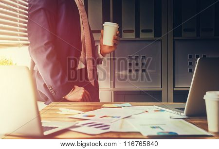 businessman drinking coffee at his workplace in the office. coffee break.