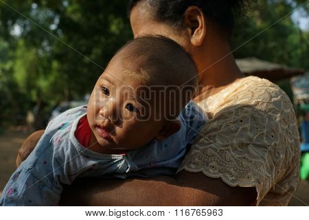 Baby of Burmese with thanaka on his face