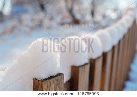 Snow-covered Old Rural Wooden Fence