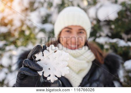Beautiful Woman Holds A Big Snowflake Winter