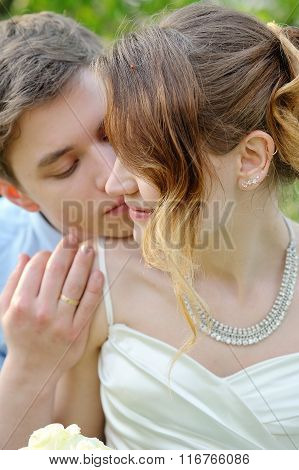 Bride And Groom Kissing In The Spring Garden