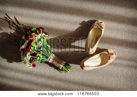 Beautiful Wedding Bouquet And Bride's Shoes Near The Window
