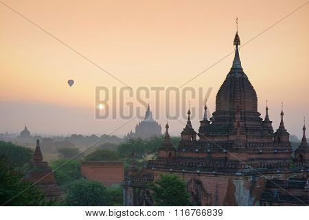 Pagoda landscape under a warm sunset in the plain of Bagan.