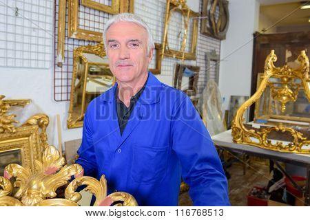 Portrait of man in antique shop