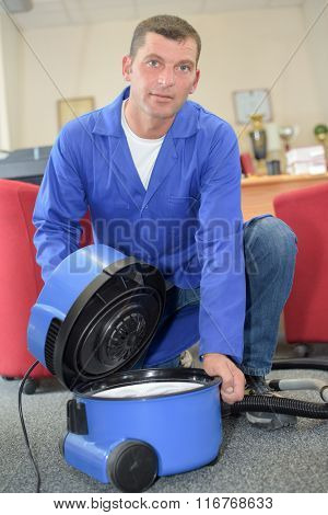 man with a hoover