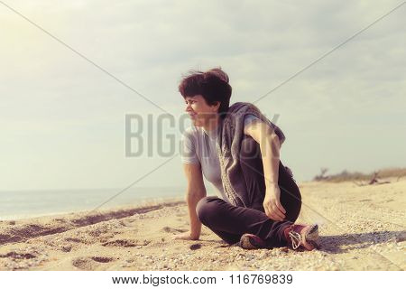 Attractive Woman Resting On The Beach