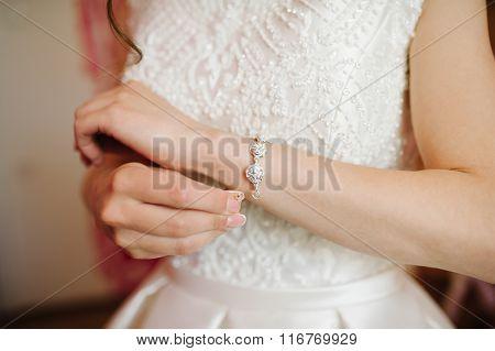 Bride Getting Bracelet Dressed On Her Wedding Day