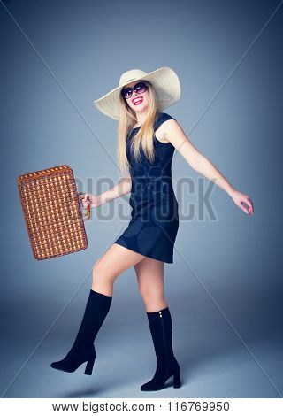The traveler woman with retro suitcase