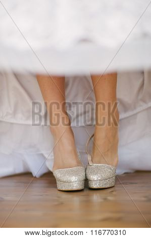 Bride Getting Dressed Shoes On Her Wedding Day