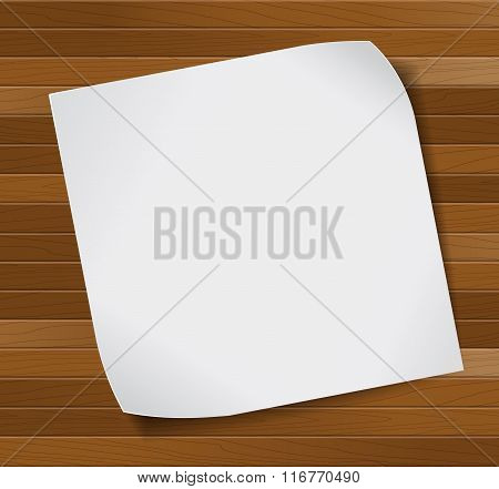 Paper sheet over wooden background.