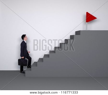 Business Man Stepping Up On Stairs To Red Flag (business Success)