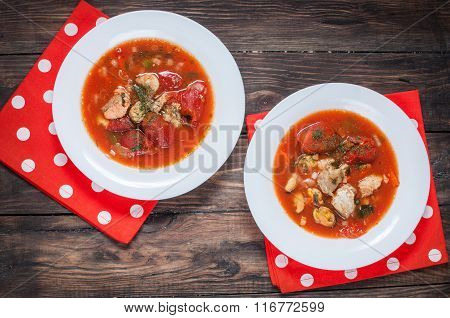 Delicious Mediterranean style tomato seafood soup with a variety of mixed seafood