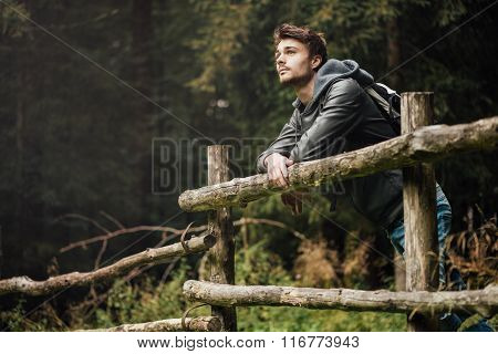 Young Man Hiking In The Forest