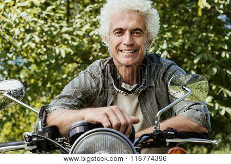 Confident Man Riding A Motorbike