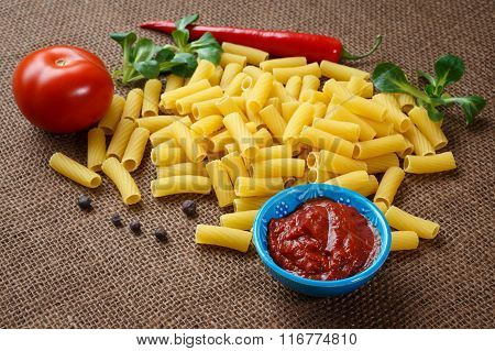 Rigatoni Raw Pasta On Background Of Jute
