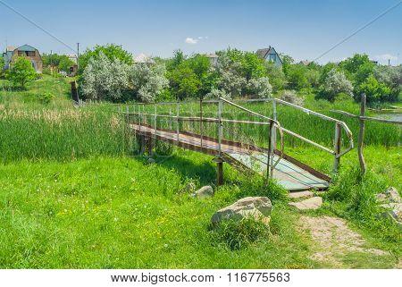 Iron footbridge over small river
