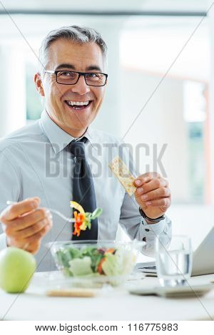 Smiling Businessman Having A Lunch Break