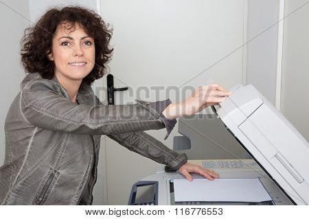 Attractive Businesswoman Close To A Copy Machine