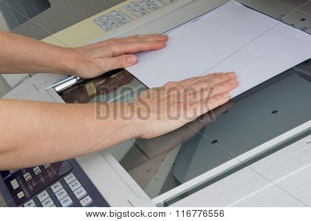 Woman Hands Putting A Sheet Of Paper Into Copying Device