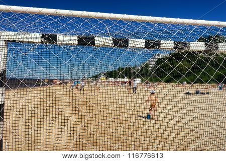 The Boy With A Ball On The Beach In The Summer At The Football Goal