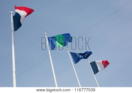 French And European Flag Against Blue Sky.