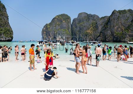 PHI PHI ISLANDS, THAILAND - CIRCA FEBRUARY, 2015: People rest on the famous beach of Maya Bay on Phi Phi Leh island. It starred the popular movie The Beach with the actor Leonardo DiCaprio