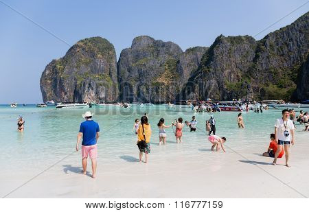 PHI PHI ISLANDS, THAILAND - CIRCA FEBRUARY, 2015: Tourists relax on the famous beach of Maya Bay on Phi Phi Leh island. It starred the popular movie The Beach with the actor Leonardo DiCaprio