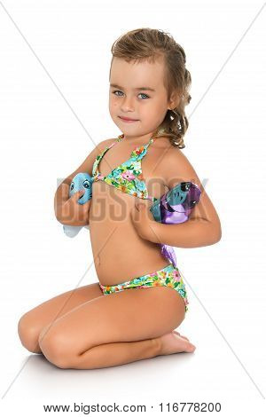 Cute girl in a swimsuit