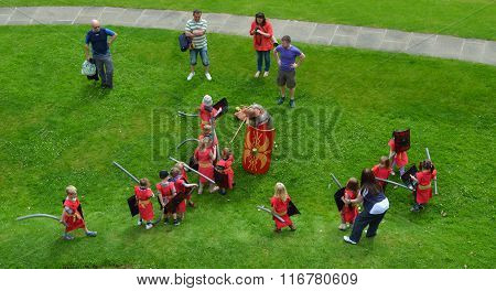 Children pretending to be Roman Soldiers