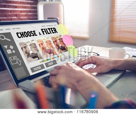 Smartphone app menu against cropped image of graphic designer working on laptop