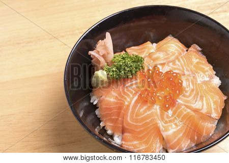 Salmon Ikura Don On Wood Table.