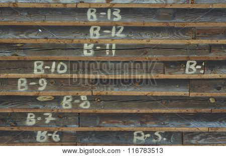 blockhouse wood wall with laths and numerals. orange grey.