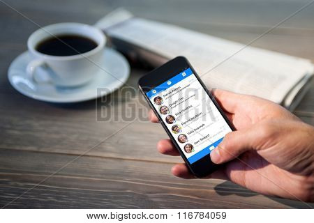 Smartphone app menu against close up of person using smartphone