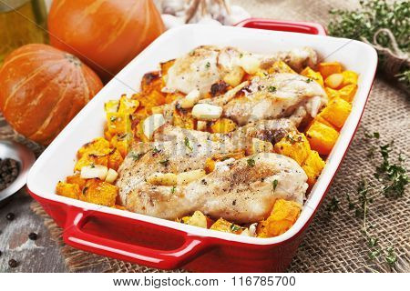 Chicken Legs Baked With Pumpkin And Garlic