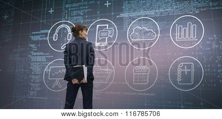 Businesswoman looking against blue matrix and codes