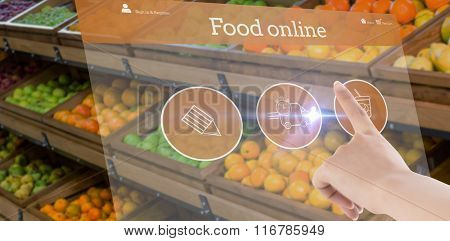 Female hand pointing against vegetable shelf at the supermarket