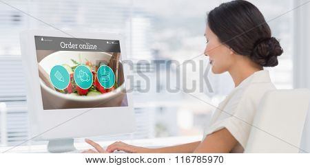Food app against young businesswoman using computer in office