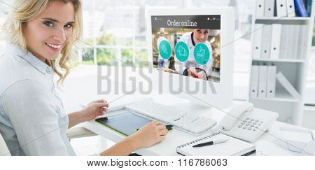 Portrait of a smiling young woman using computer against food app