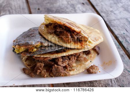 Traditional Mexican Gorditas Stuffed With Cheese, Veggies And Meats. Shallow Depth Of Field