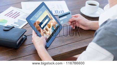 Food app against businesswoman using tablet pc and holding credit card