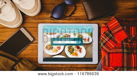 Food app against tablet shirt jean shoes smartphone wallet and bag
