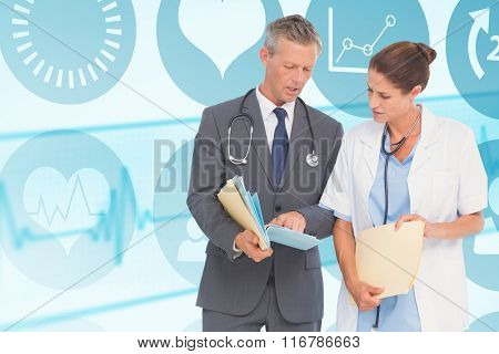 Male and female doctors discussing over reports against medical background with blue ecg line