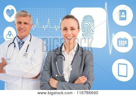 Smiling doctors with arms crossed against medical background with blue ecg line