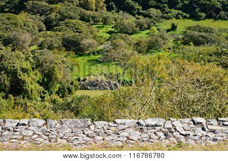 Landscape with a small ancient structure at the archaeological site of Chinkultic in Chiapas, Mexico