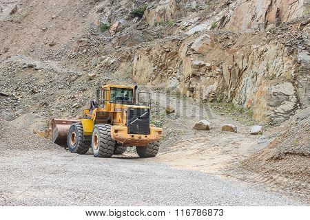 Yellow Mining Excavator In Stone Pit