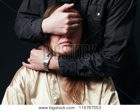 Man's  Hands Are Choking Woman