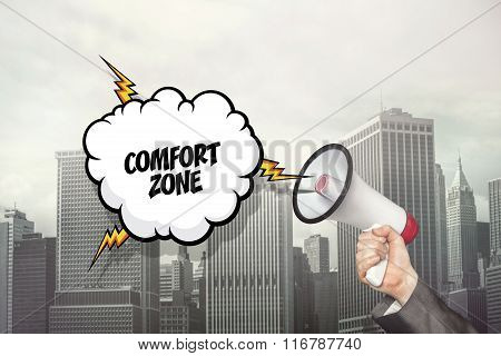Comfort zone text on speech bubble and businessman hand holding megaphone