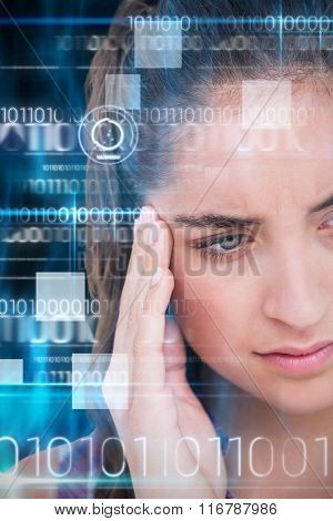 Close-up of beautiful woman suffering from headache against blue technology design with binary code