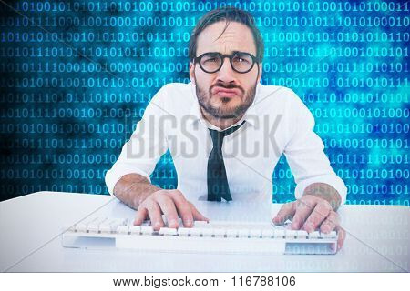 Business worker with reading glasses on computer against shiny blue binary code on black background