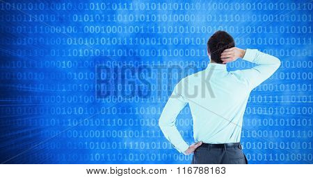 Thinking businessman with hand on head against glowing futuristic binary code